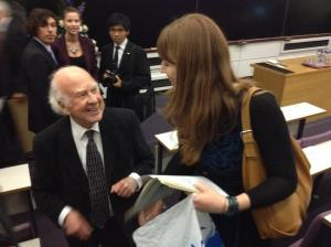 Professor Higgs just after he had signed my NYT newspaper of the discovery of the Higgs boson at CERN. Photo credit: S.Marsden. (Also, note I'm not a giant, just  on the stairs)