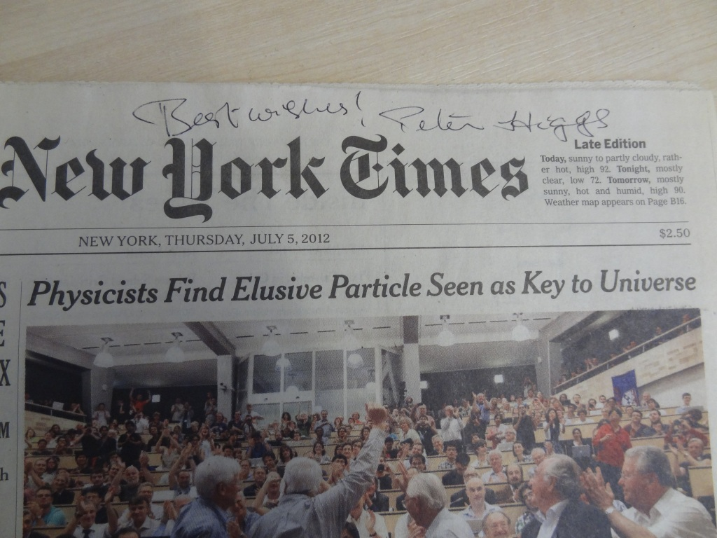 Signed copy of the front page of the New York Times from the day after the Higgs boson announcement, July 2012.