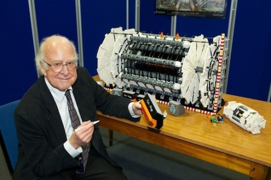 Professor Higgs signing the ATLAS LEGO rebuilt at the University of Manchester.