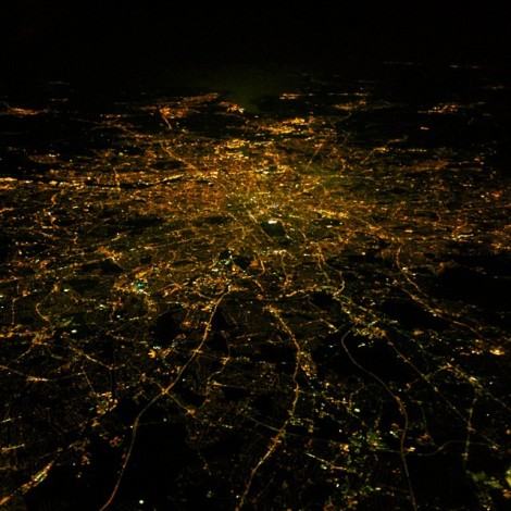 I was already trying to take a picture of the moon through the plane window so I was playing around with the low light settings on my camera. Then we passed over London - perfect! Taken December 2014.